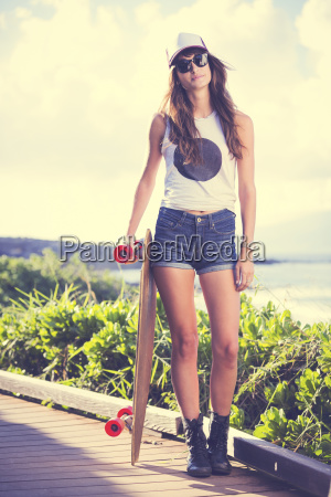 beautiful hipster girl with skate board