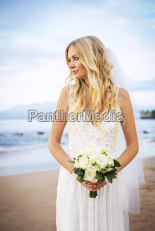 beautiful bride in wedding dress with