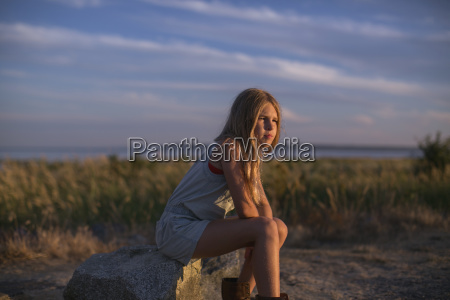 girl in contemplation sitting on a