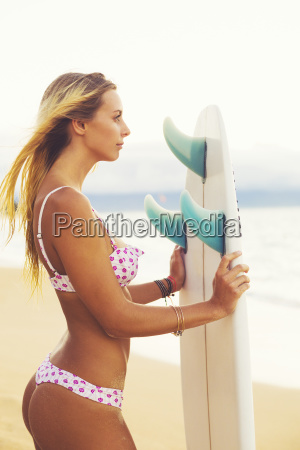 beautiful blonde surfer girl on the