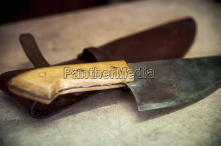 a knife laying on a leather
