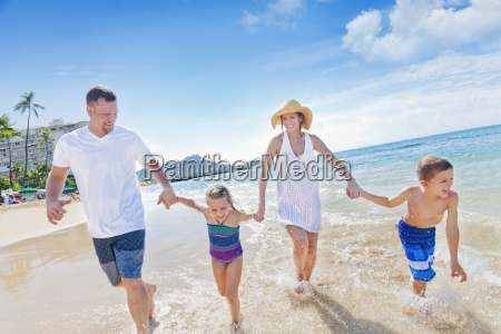 family of four enjoying a summer