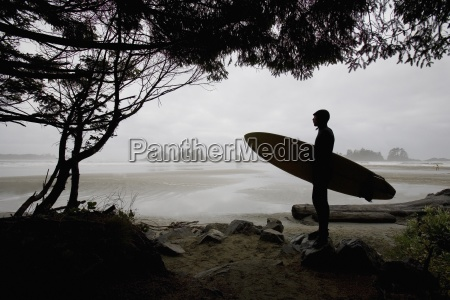 silhouette of a surfer looking out