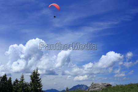 paragliders in the blue sky