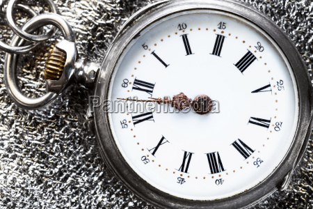 vintage pocket watch on silver cloth