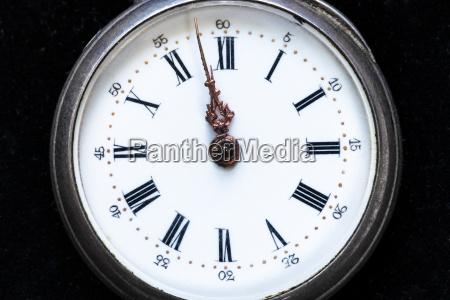 retro pocket watch on black velvet