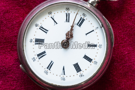 retro pocket watch on red velvet