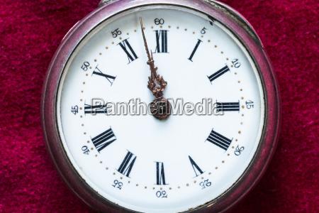 vintage pocket watch on red velvet