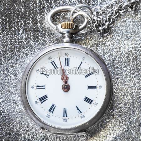 antique pocket watch on silver cloth