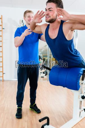 man at gym on workout bench