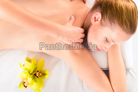 woman having wellness massage in spa