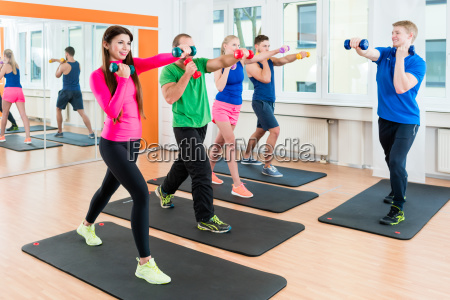 group of athletes in gym doing