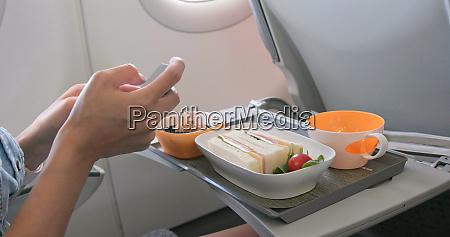 woman taking photo on her flight