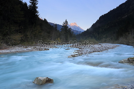 cold river with mountain peak