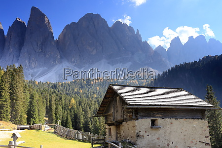 beautiful mountain landscape with old lodge