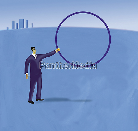 businessman holding up hoop