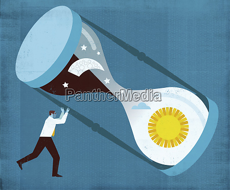 businessman turning hourglass with sun and