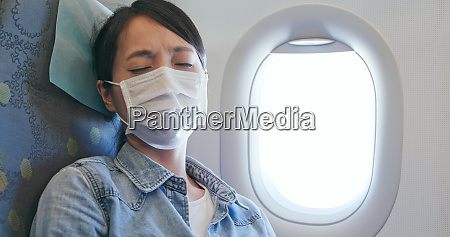 woman feeling unwell and wearing face