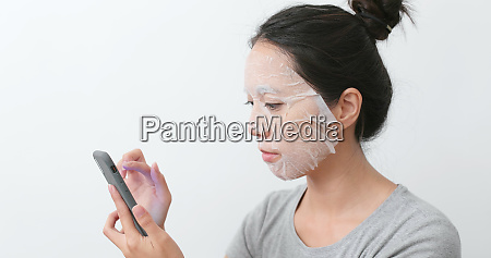 woman apply mask on face and