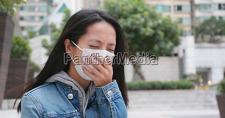 woman coughing with wearing face mask