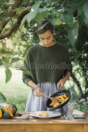 young woman with homemade pumpkin gnocchis