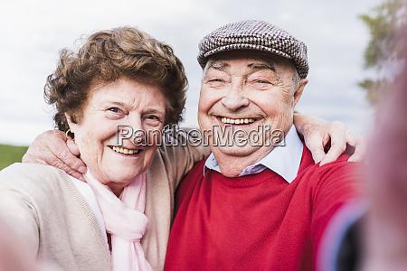 selfie of happy senior couple outdoors