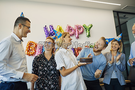 colleagues having a birthday celebration in