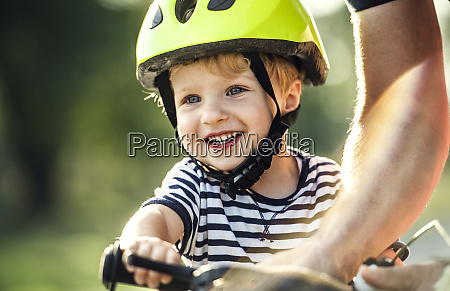 portrait of smiling toddler wearing cycling