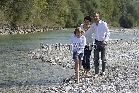 family walking at the river isar