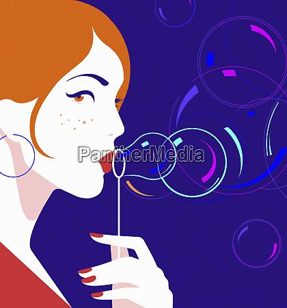 bella donna che soffia bolle