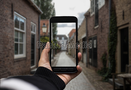 hand holding the black smartphone with