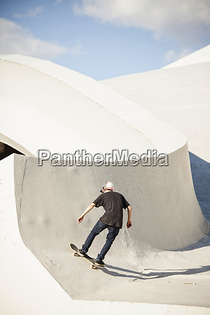caucasian man skating at skate park