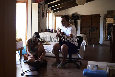 father playing guitar and mother playing