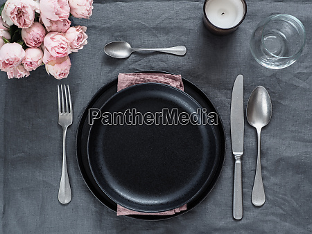 beautiful table setting on gray linen