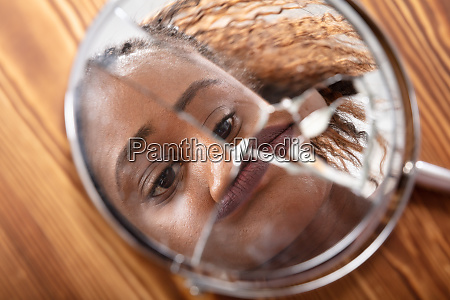 reflection of a womans face in