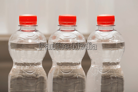 row of water bottles bubbling spa