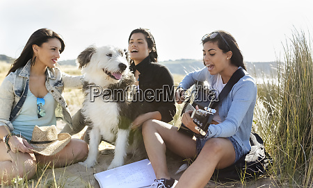 young woman with friends and dog