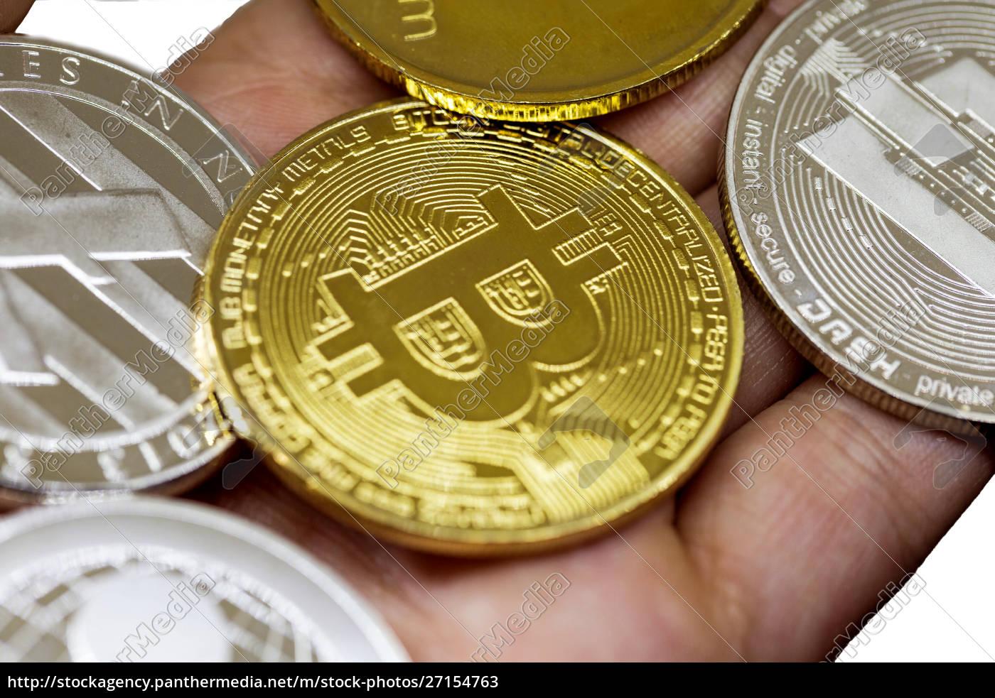 golden, bitcoin, in, a, man, hand, - 27154763