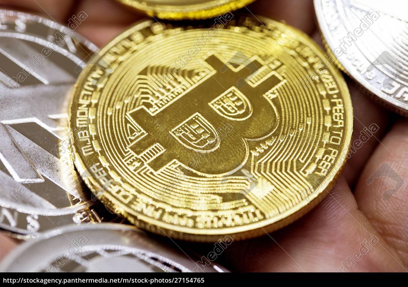 golden, bitcoin, in, a, man, hand, - 27154765