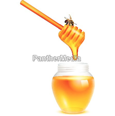 honey dripping from dipper stick with