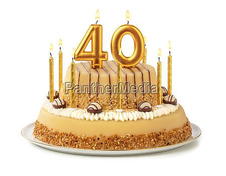 torta festiva con candele dorate