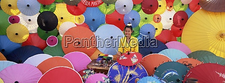 woman painting umbrellas umbrella making factory