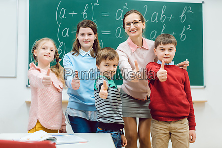 pupils and teacher in class room