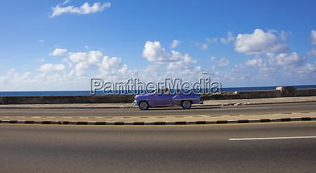 havana cuba a shiny purple convertible