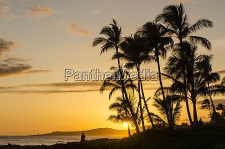 sunset at poipu beach kauai hawaii