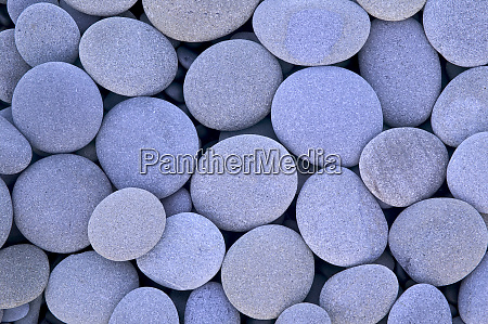 round and flat grey blue stones
