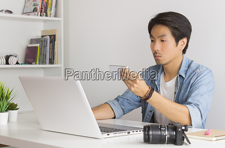 asian photographer or freelancer checking photo
