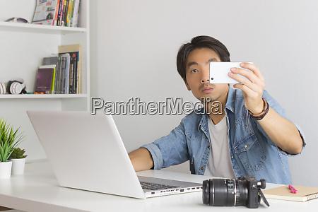 asian photographer or freelancer selfie or