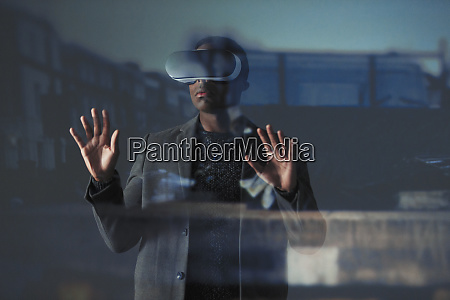 double, exposure, businessman, using, virtual, reality - 27457211