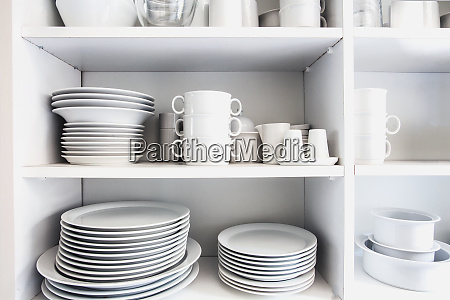 white cupboard with white crockery in
